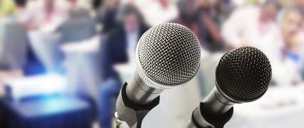 two-microphones-press-conference_header.png